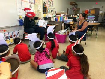 Asia Smith reads to school children.