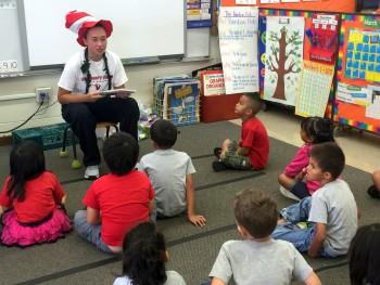 Kim Schmelz reads to school children.