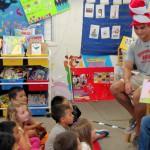 Students reads to school children.
