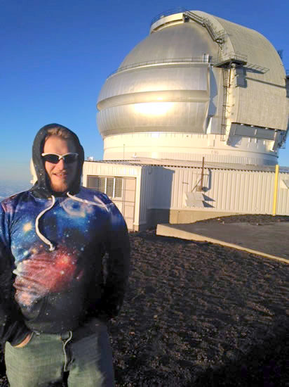 Derek standing in front of observatory dome.