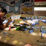 School child doing crafts.