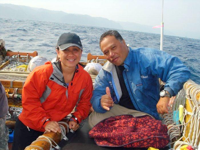 Ka'iu Kimura and Kālepa Babayan aboard the Hōkūle'a, ocean in background.