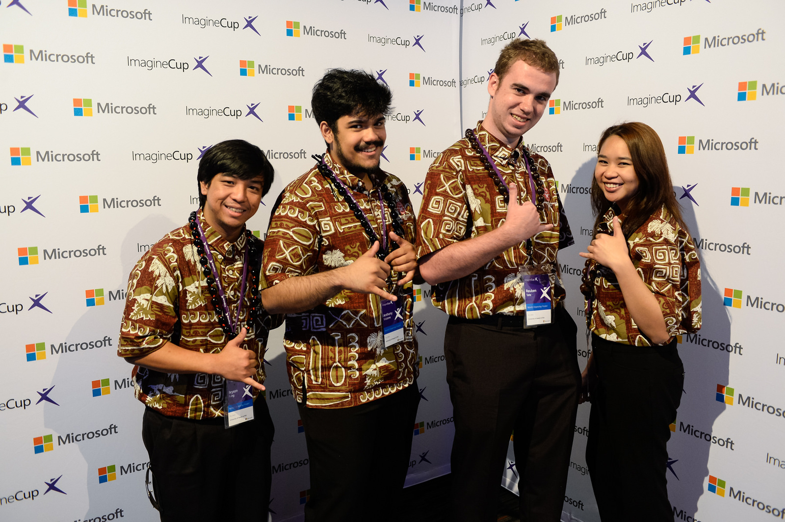 UH Hilo team of four in matching brown aloha shirts stand for photo: Bryson Fung, Anthony Vizzone, Reuben Tate, and Pauleen Pante.