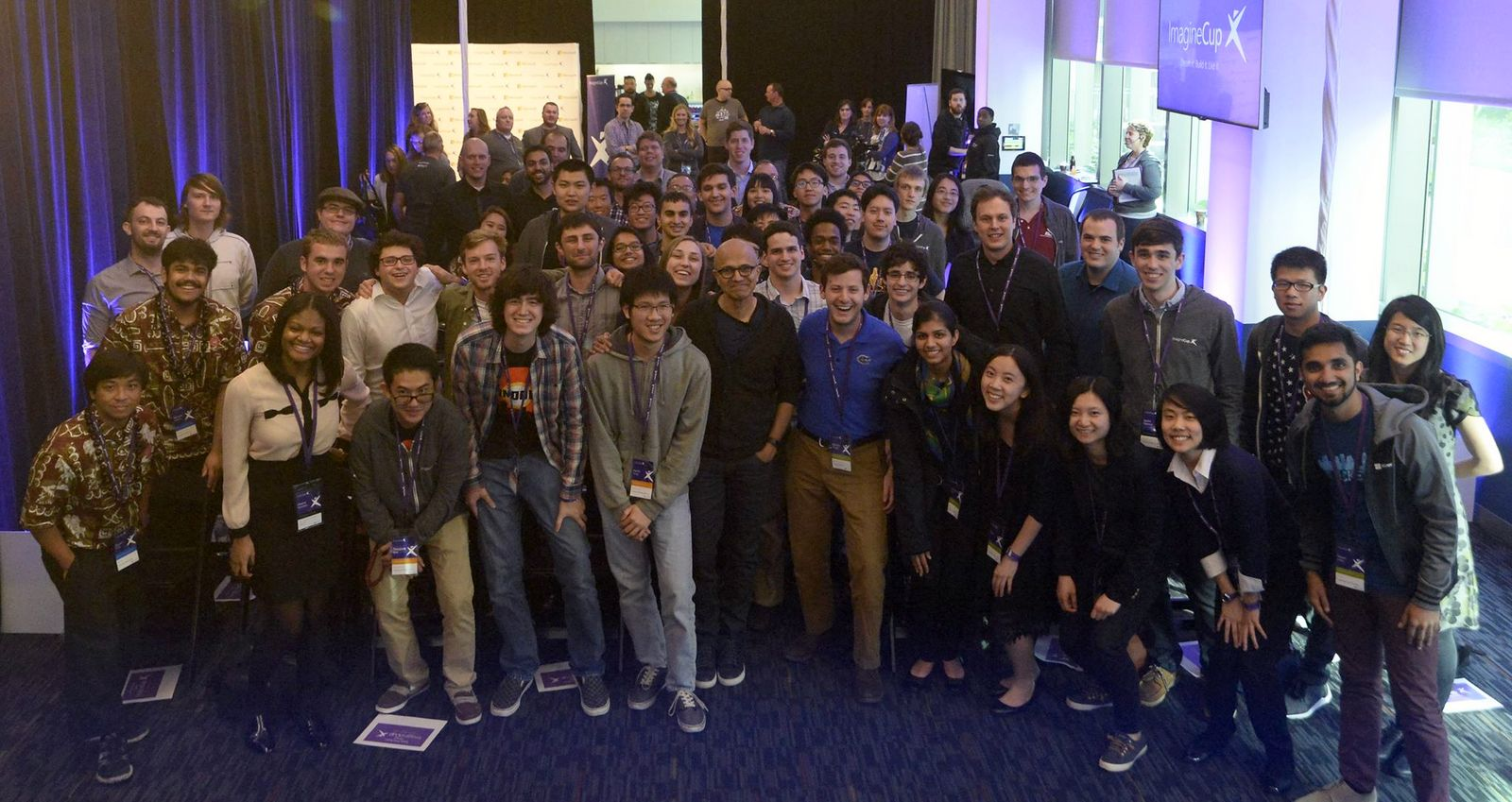 Group photo of all Imagine Cup teams standing together. UH Hilo team at front left in their aloha shirts.