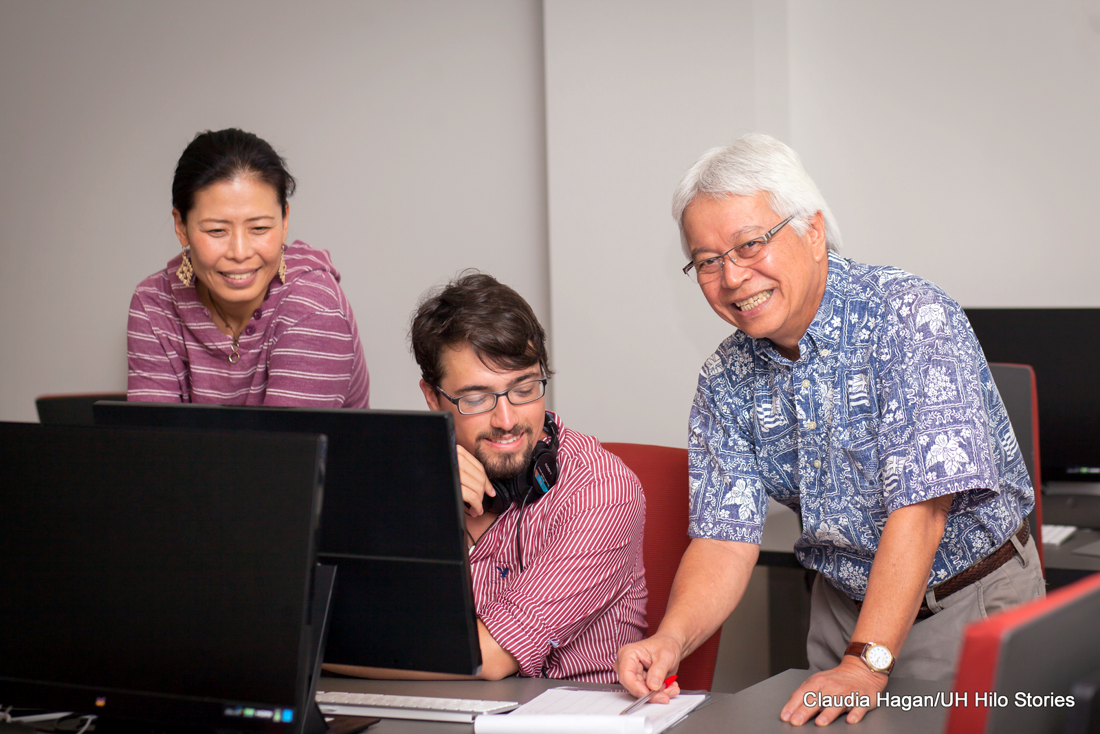 Larry Kimura with students in the language lab.