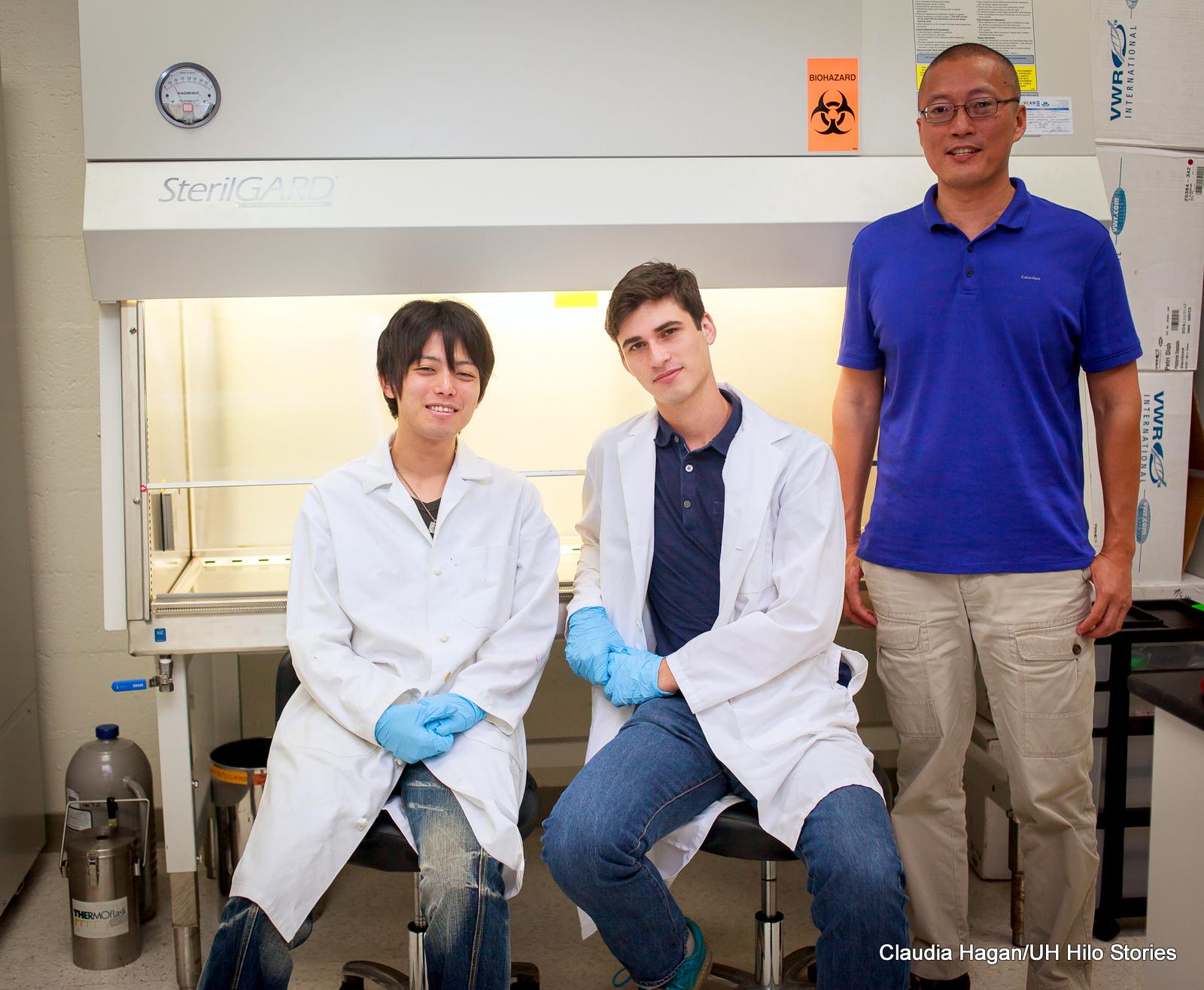 Professor Tao stands with Gin Tezuka and Luke Kupcha.