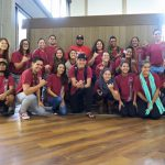 Group photo, students have on their red UH Hilo shirts.