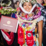 Graduate with Lei up over her head.