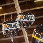 "Balloons with the words ""Go Grad!"""