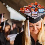 Graduate with decorated mortarboard.