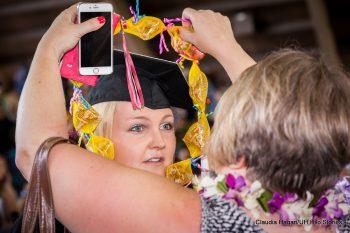 Graduate receiving lei.