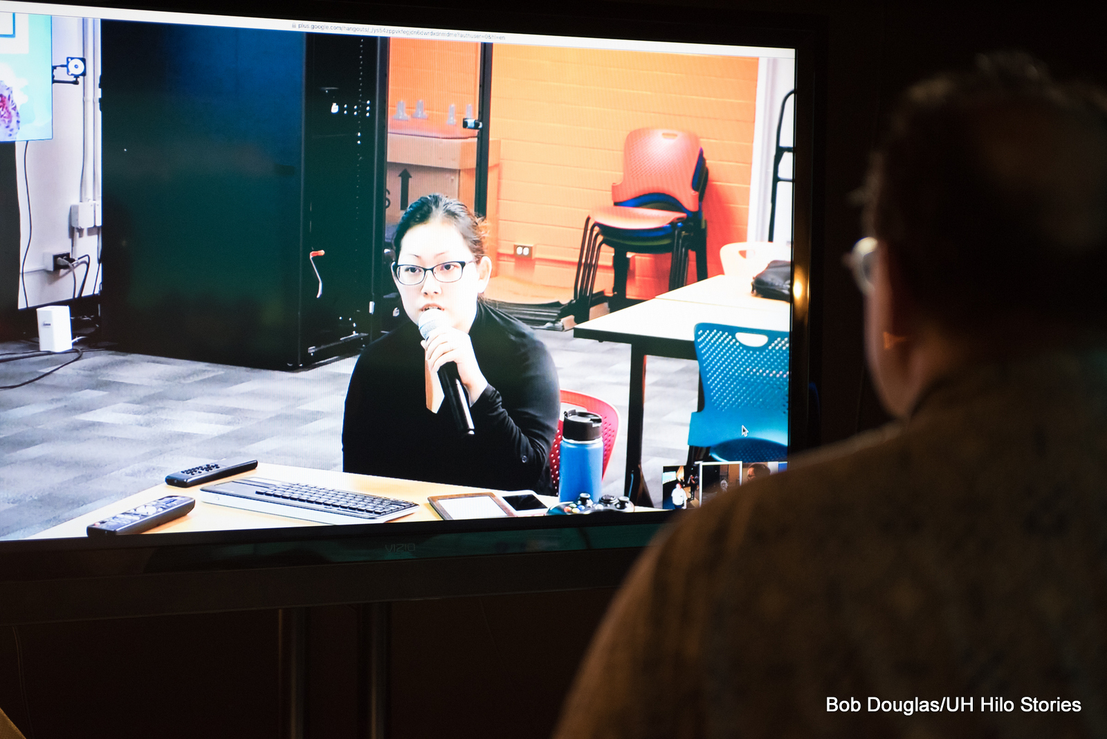 Person viewing student speaking on screen from another location.