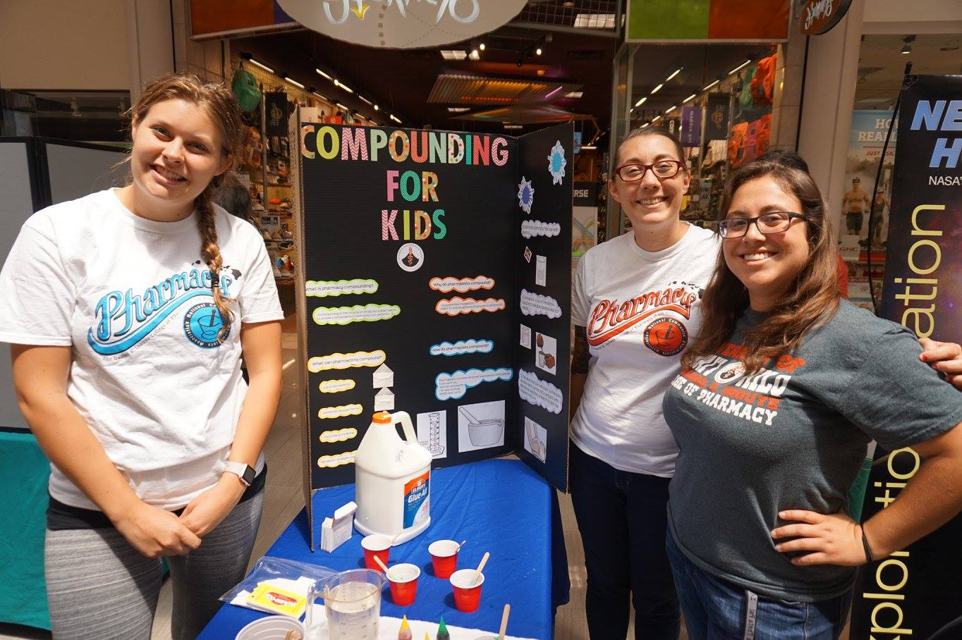 "Karen Christian, Athena Borhauer, and Stephanie Ramirez at their booth ""Compounding for Kids.""."