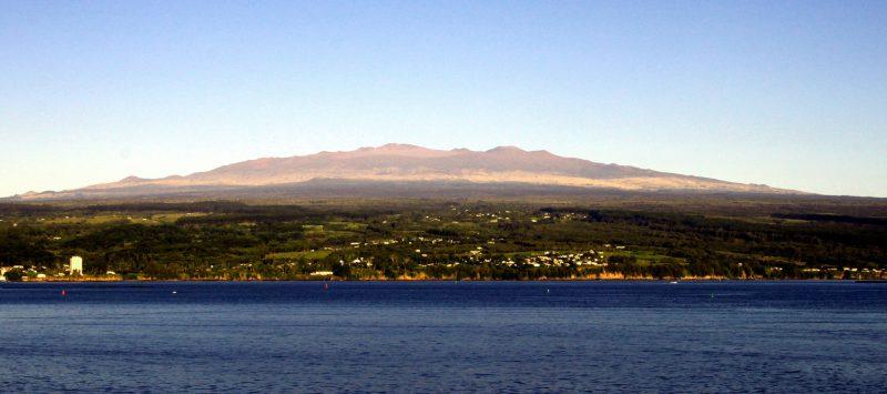 Maunakea behind Hilo Bay.
