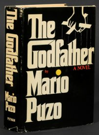 Book cover The Godfather A Novel, Mario Puzo. Black and while with the hands of a puppeteer holding strings.