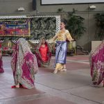 Women dancing with colorful shawls.