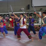 Men dancing with swords