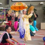 Women dancing with fancy parasol.