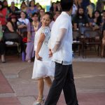 Couple in white dancing.