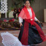 Women in shawls dancing.