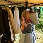 Cast member looking through wardrobe selection.
