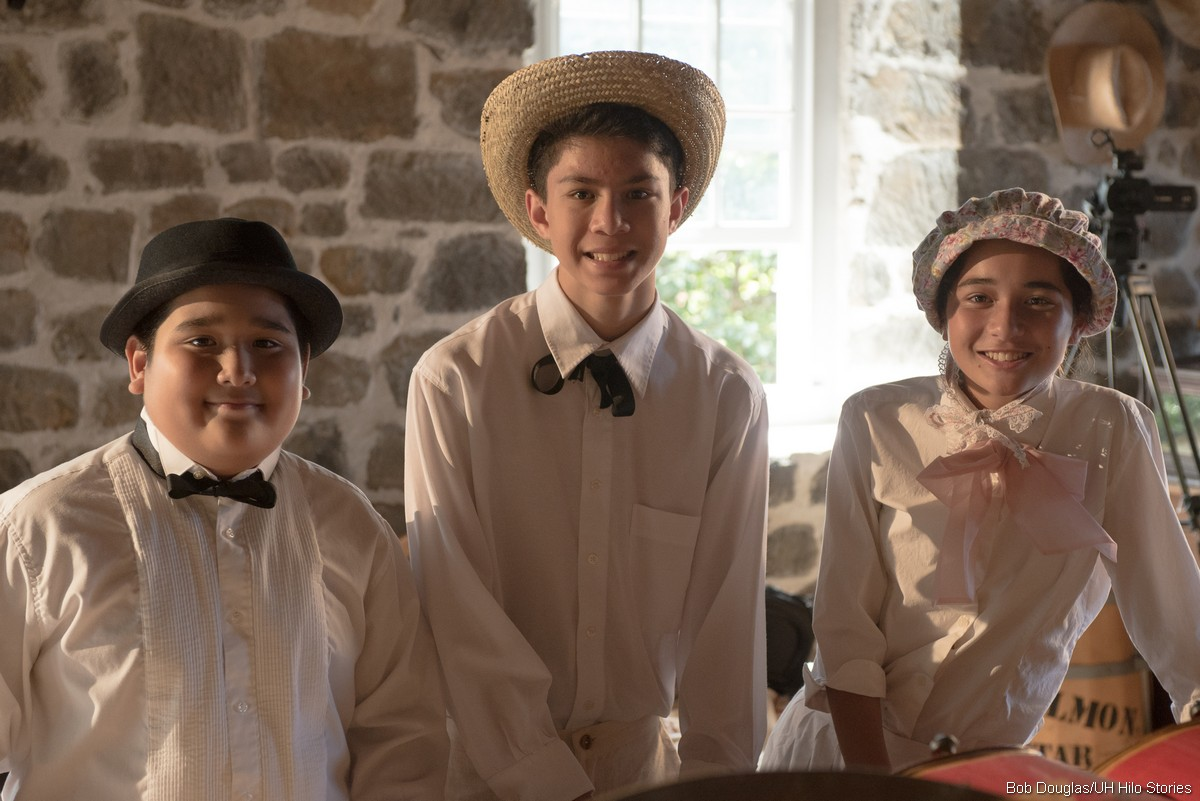 Young cast members in costume.