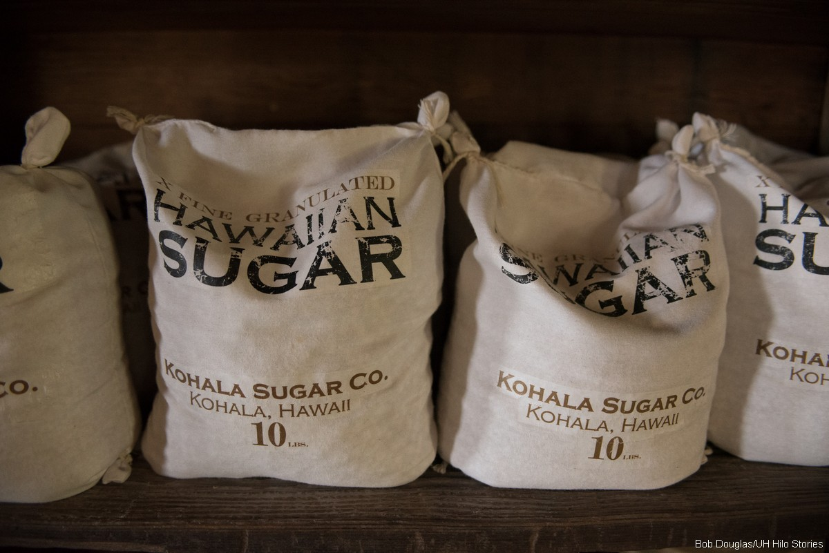 Packages of sugar on set.