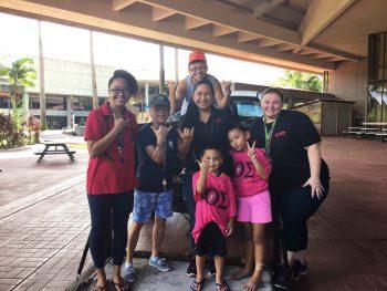 Group photo of work crew on library lanai