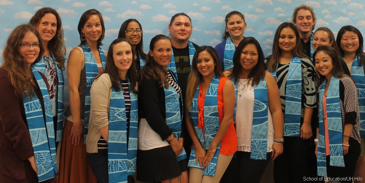 Master of Arts in Teaching cohort in their master degree sashes, spring 2015