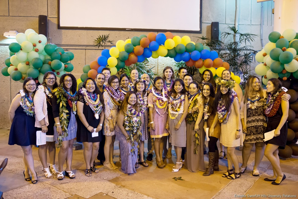 Current Master of Arts in Teaching cohort poses for photo at the Annual Teacher Candidate Reception held in May. Balloons, lei and smiles.