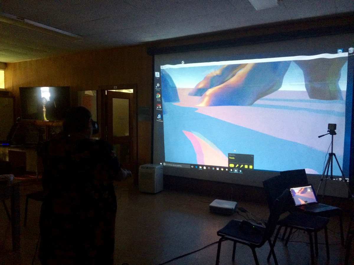 Student working with images on big screen.