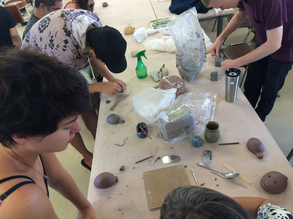 Students working with materials on a table.