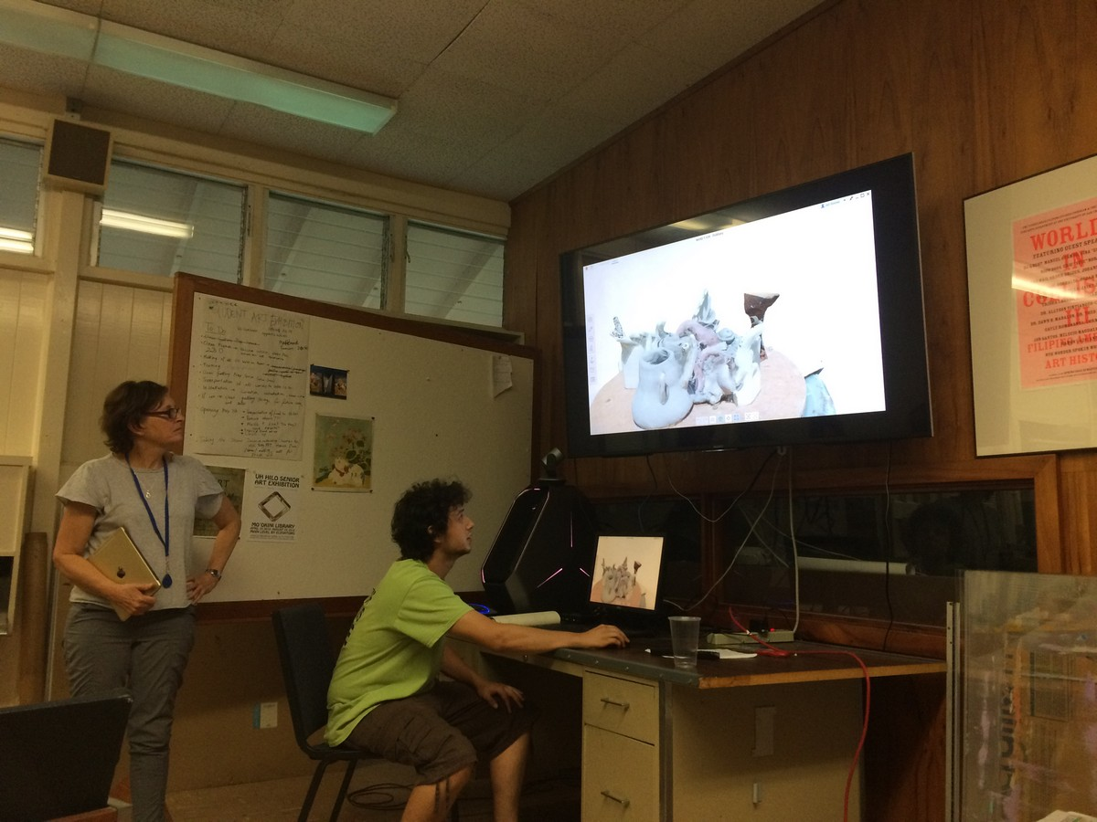 Student works on big screen.