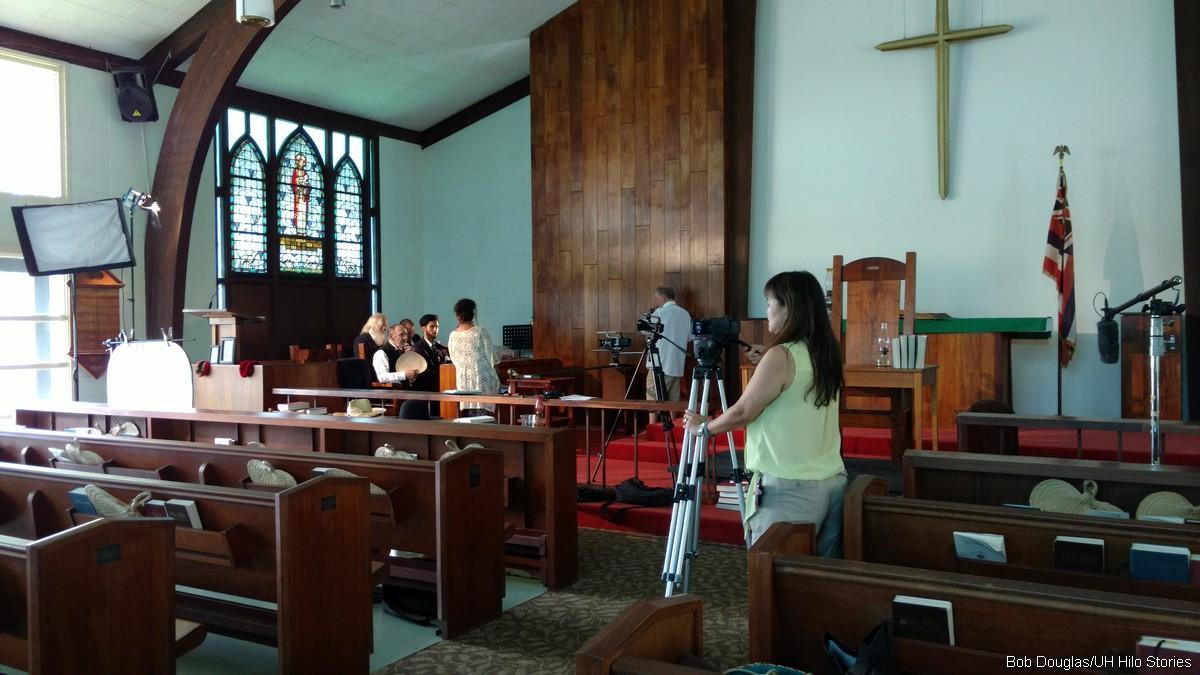 Film crew setting up court scene.