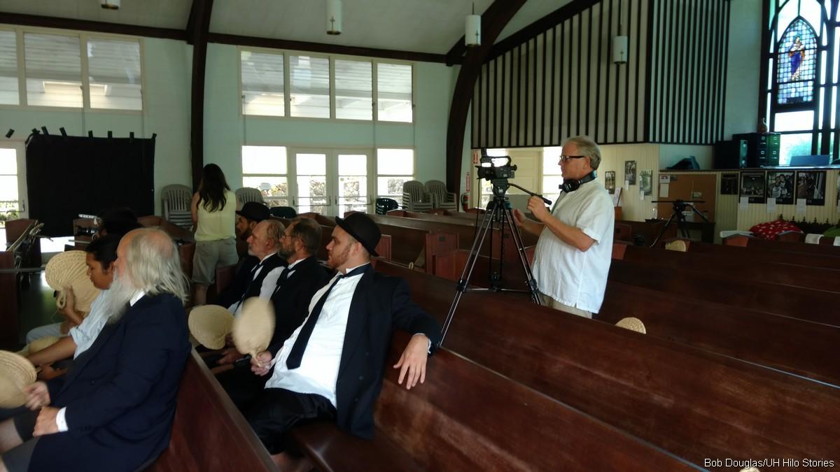 Cameraman shoots court scene.