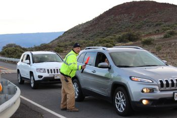 Maunakea staff greets cars.