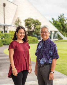 Kaiu Kimura and Larry Kimura stand in front of 'Imiloa Astronomy Center.