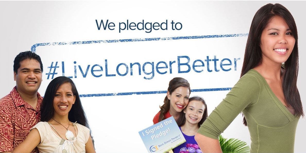 "A poster with 5 smiling people and the words, ""We pledged to #LiveLongerBetter, I signed the Pledge!"""