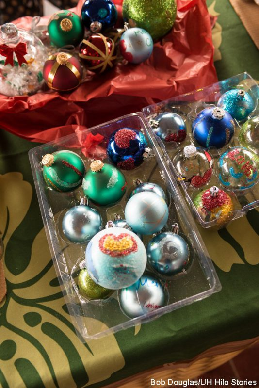 Ornaments on display on the booth table.