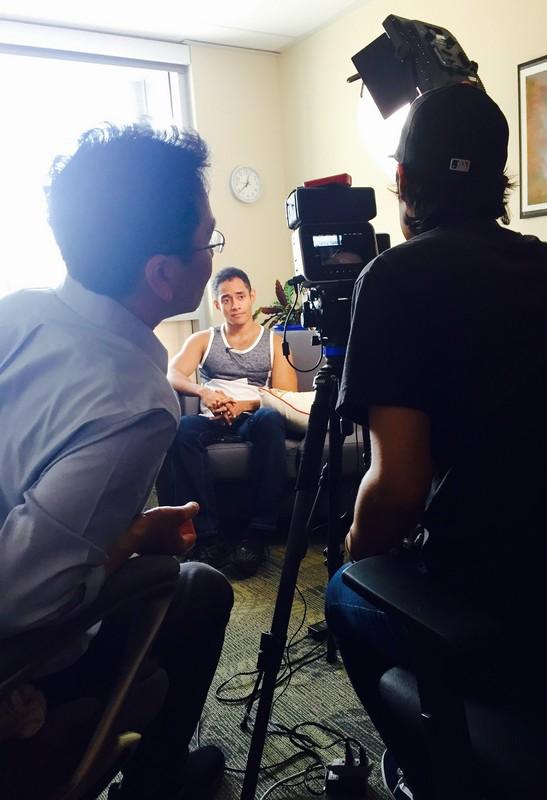 Filmmakers conducting interview.