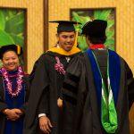 Graduate student is hooded.