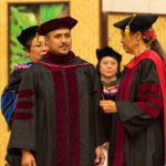 Doctoral student is hooded.