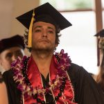 Student speaker with lei.
