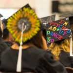 Messages and artwork on top of candidates' mortarboards.