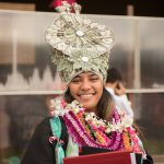 Graduate in traditional headdress.