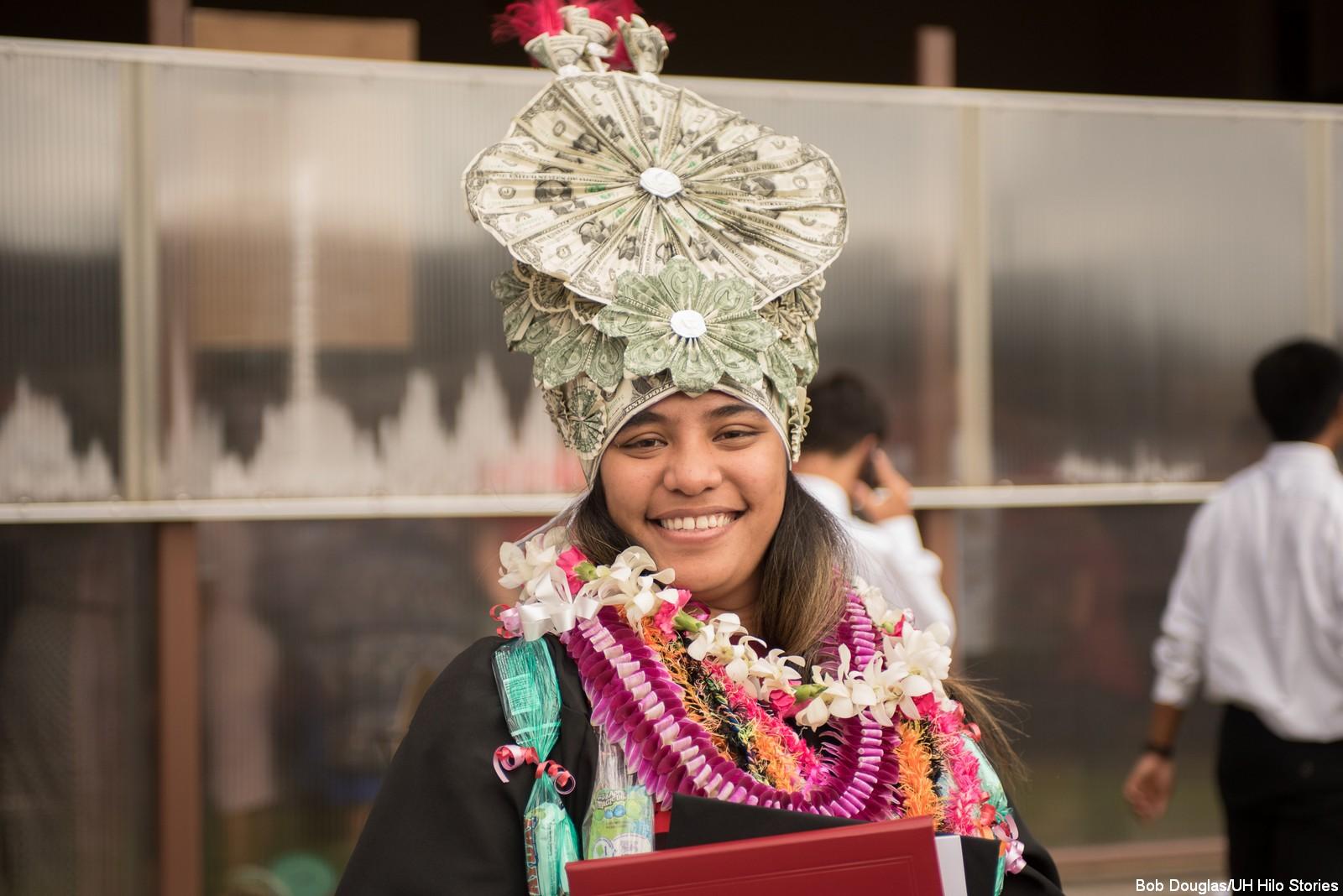 Graduate in traditional headdress.