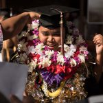 Graduated bedecked with lei.