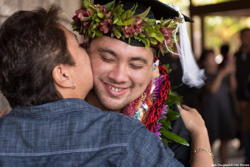 Graduate gets a kiss.