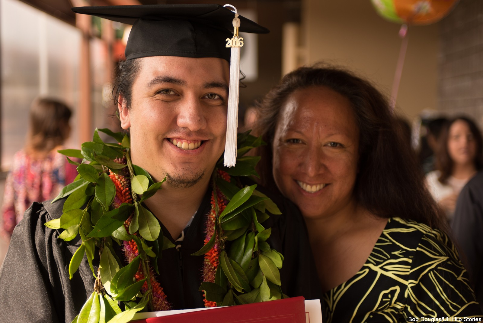 Graduate with his mom.