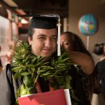 graduate receives lei from mom.